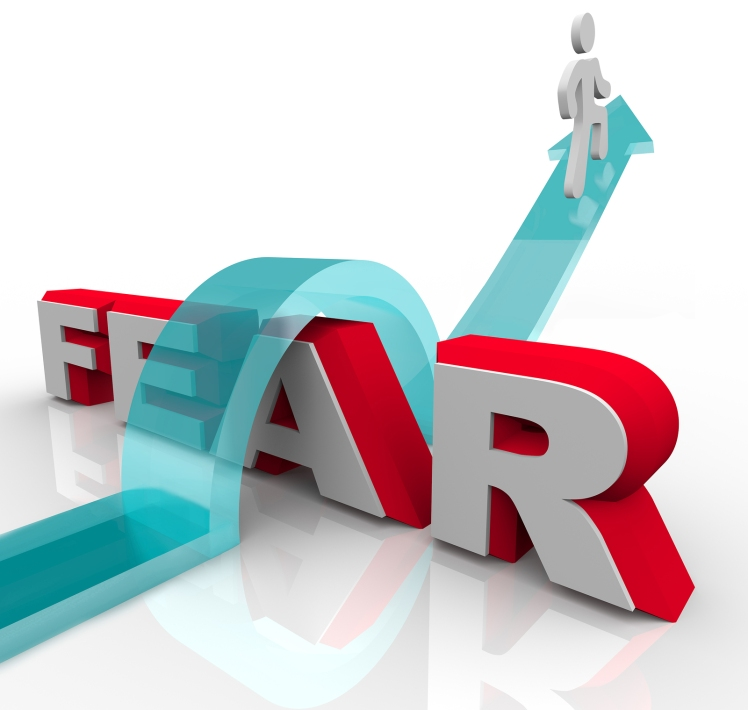 bigstock-a-man-jumps-over-the-word-fear
